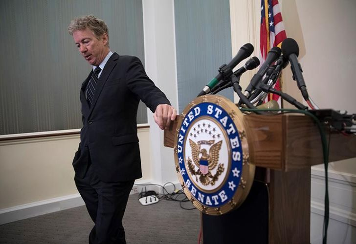 Senator Rand Paul, R-Ky., pauses following a news conference where he told reporters that he plans to oppose President Trump's nominations at the Capitol in Washington, Wednesday, March 14, 2018.