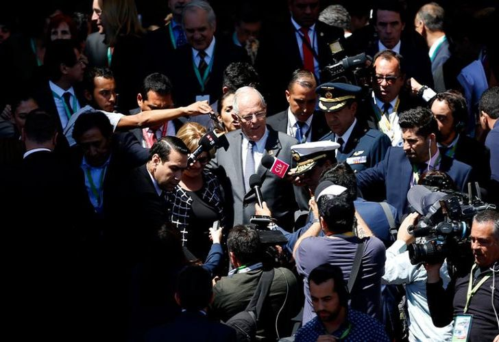 Peru's President Pedro Pablo Kuczynski (centre) leaves the Congress in Valparaíso, Chile, after attending the swearing-in ceremony of Chilean new President Sebastian Piñera (out of frame), on March 11, 2018.