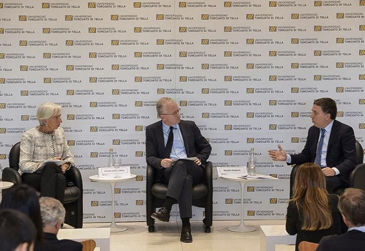 International Monetary Fund (IMF) managing director Christine Lagarde speaks at the Torquato Di Tella University in Buenos Aires alongside Treasury Minister Nicolás Dujovne (right)