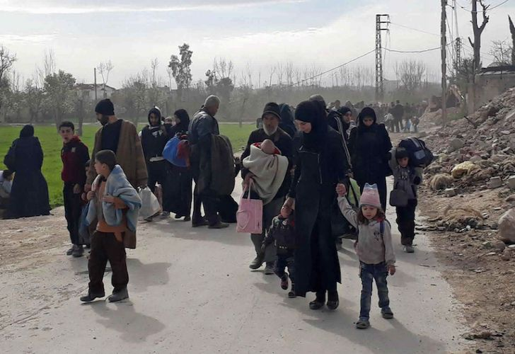 Syrian civilians flee fighting between government forces and rebels in Hamouria in eastern Ghouta, a suburb of Damascus, Syria on Thursday.
