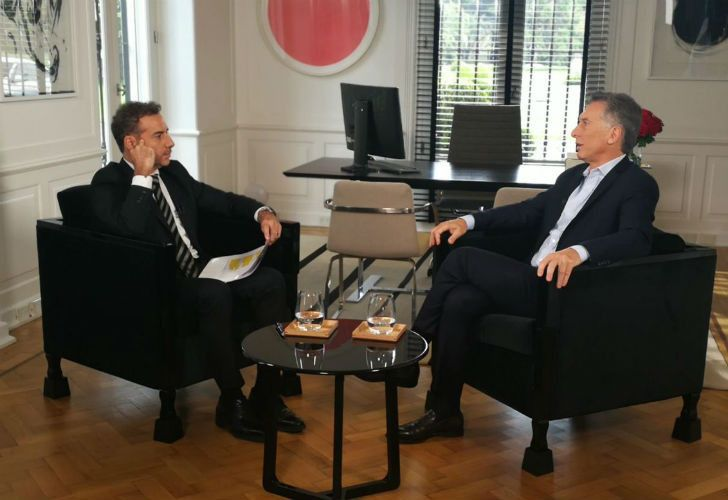 President Mauricio Macri (right) speaks with broadcast journalist Luis Majul.