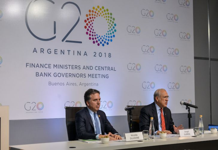 Nicolás Dujovne, the Argentine finance minister, and José Ángel Gurría, secretary-general of the OECD, speak at a press conference on the first day of G20 finance leader meetings in Buenos Aires on Monday.