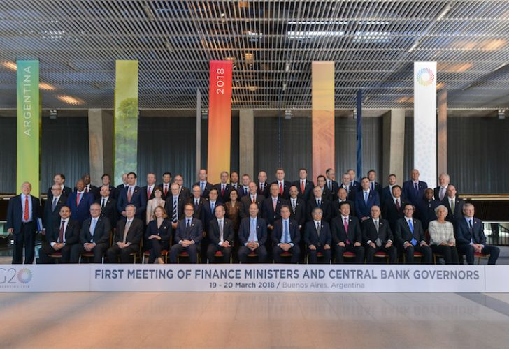 Finance ministers and central bank governors pose for a group photo at the end of the first day of G20 talks in Buenos Aires on Monday.