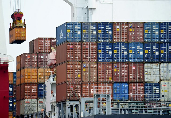 In this August 5, 2010 file photo, a container is loaded onto a cargo ship at the Tianjin port in China.