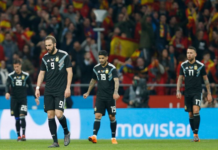 Argentina's players react after Spain score another goal during the 6-1 international friendly match against Spain at the Wanda Metropolitano stadium in Madrid.