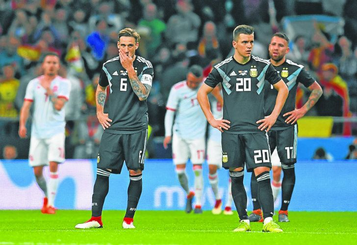 Argentina midfielder Lucas Biglia, midfielder Giovani Lo Celso and defender Nicolas Otamendi react after Spain's sixth goal, during Tuesday's 6-1 international friendly defeat at the Wanda Metropolitano Stadium in Madrid.