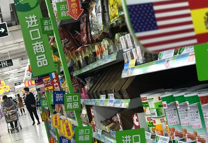 China raised import duties on a US$3-billion list of US pork, fruit and other products Monday in an escalating tariff dispute with US President Donald Trump that companies worry might depress global commerce.