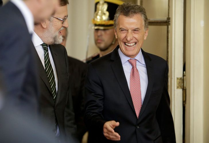 President Mauricio Macri, right, laughs with Spain's Prime Minister Mariano Rajoy, left, as they arrive for a joint press conference at the Casa Rosada earlier today.