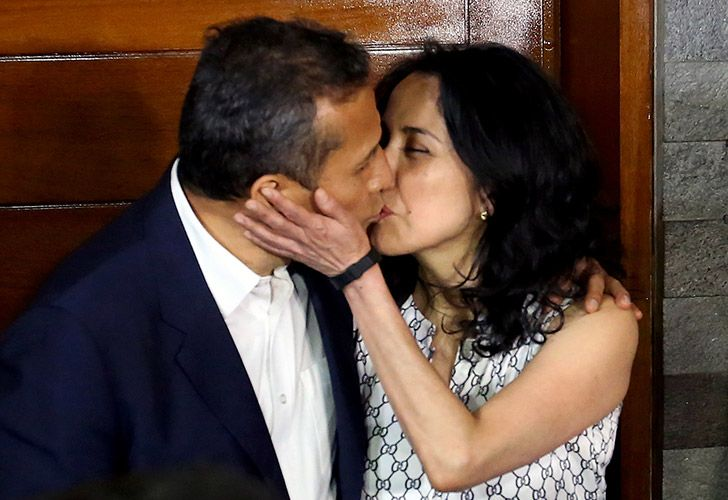 Peru's former president (2011-2016) Ollanta Humala and his wife Nadine Heredia kiss outside their home after being released from preventative detention awaiting trial on charges of money-laundering, in Lima on April 30.