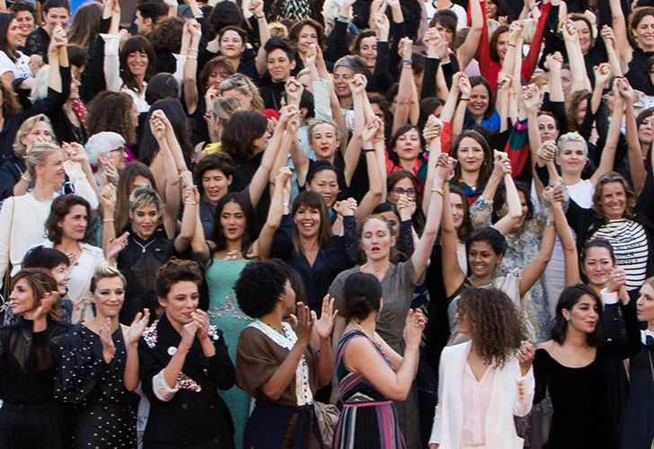 Women filmmaker gather for a photo-op at the 2018 Cannes film festival.