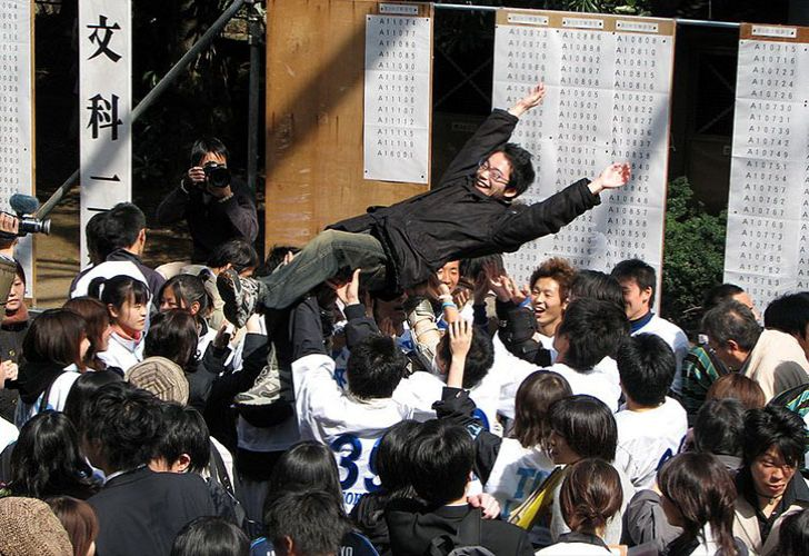 The Tokyo University entrance exam results on display. With Tokyo University being the most prestigious university in Japan, passing these exams is a major step in one's personal life. By tradition, new students are cheered on by current students and thrown in the air.