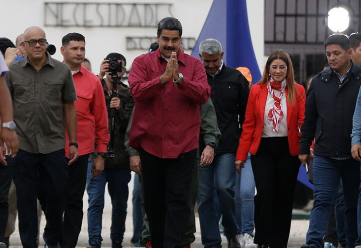 Venezuela's President Nicolas Maudro gestures to supporters after voting in the presidential election in Caracas, Venezuela, Sunday, May 20, 2018