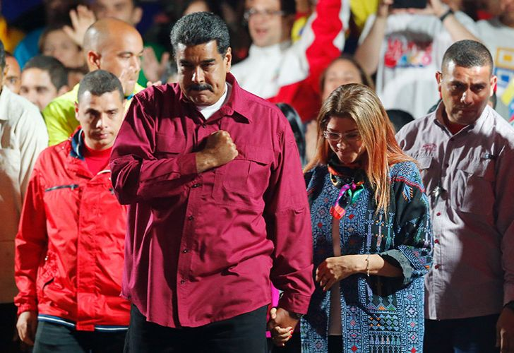 Venezuela's President Nicolas Maduro arrives to address supporters at the presidential palace after his May 20, 2018 election win.