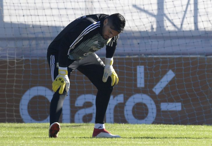 Sergio Romero stretches during a training session in Ezeiza. The Manchester United goalkeeper injured his right knee during a training session on Tuesday and will miss the FIFA 2018 World Cup starting next month in Russia.