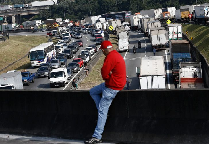 Brazilian truck drivers block the Regis Bittencourt road, 30 kilometres from São Paulo, during a strike to protest rising fuel costs in Brazil.