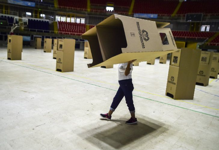 A worker assembles voting booths at a polling station in Cali, Colombia.