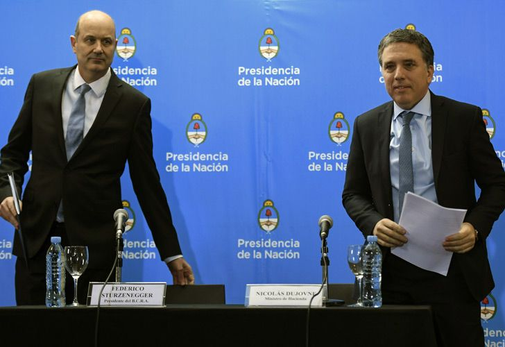 Central Bank Governor Federico Sturzenegger (left) and Finance Minister Nicolás Dujovne arrives for a press conference in Buenos Aires announcing the details of the deal with the IMF.