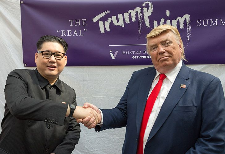 Impersonators of Kim Jong-un and Donald Trump, Howard X (left) and Dennis Alan (right) shakes hands during a promotional event in Singapore.