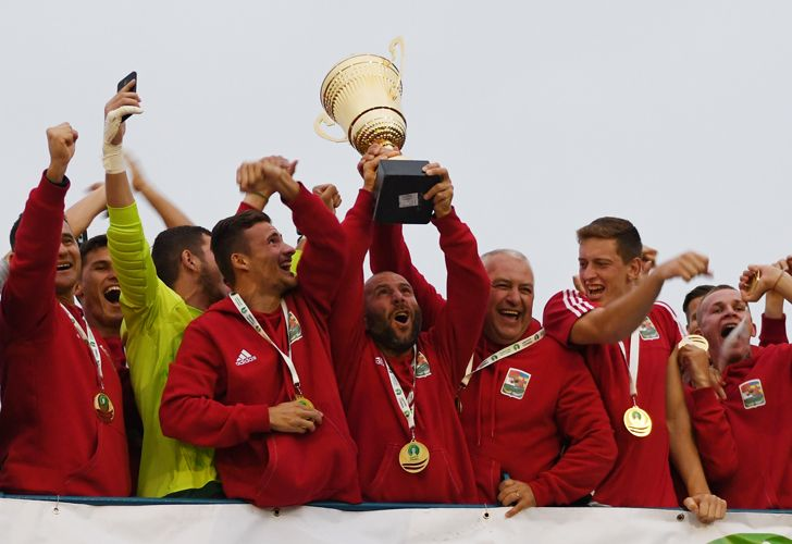 Members of the Karpatalja squad celebrate with the CONIFA alternative World Cup trophy.