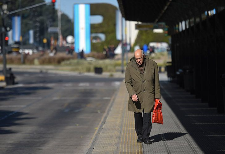 A man walks at an empty bus stop on an empty Avenida 9 de Julio on June 25, 2018, during a 24-hour general strike called by unions.
