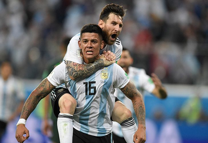 Marcos Rojo and Lionel Messi celebrate after the Manchester United defender volleyed home Argentina's second goal in their clash with Nigeria in St Petersburg