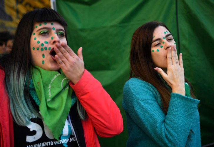 People in favour of the legalisation of abortion demonstrate outside the National Congress in Buenos Aires.