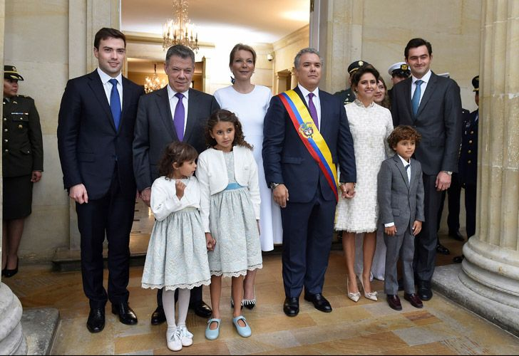 Colombia's new President Iván Duque, and his family, are phographed with former president Juan Manuel Santos and his family upon arrival at the presidential palace in Bogotá on Tuesday.