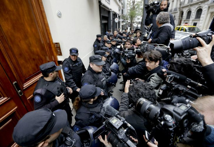 Police keep the press at bay as they search the home of Cristina Fernández de Kirchner, in Recoleta.