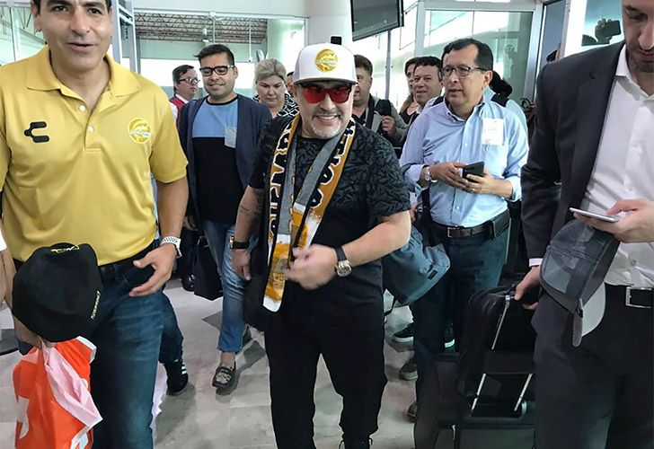 Diego Maradona walks through Culiacan airport in Mexico.