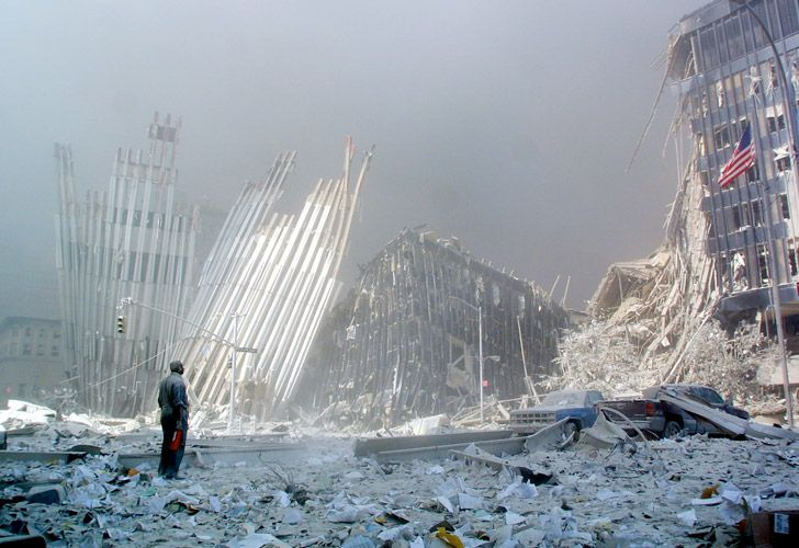 In this photo taken on September 11, 2001, a man stands in the rubble after the collapse of the first World Trade Center Tower in New York. Seventeen years later, more than 1,100 victims of the hijacked plane attacks on the World Trade Center have yet to be identified. But in a New York lab, a team is still avidly working to identify the remains, with technological progress on its side. Day in, day out, they repeat the same protocol dozens of times.