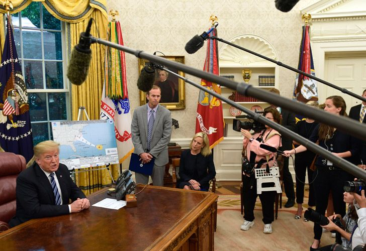 US President Donald Trump talks about Hurricane Florence, during a briefing in the Oval Office.