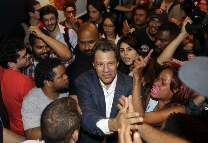 Fernando Haddad greets students during an event in São Paulo.