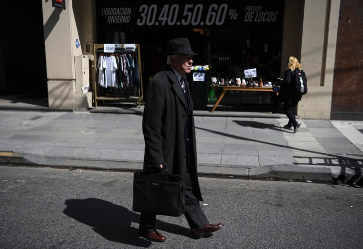 A man walks along the street in downtown Buenos Aires.