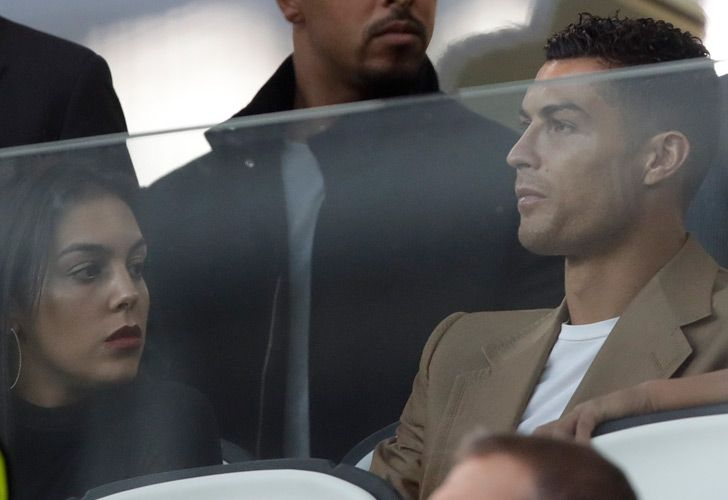 Juventus forward Cristiano Ronaldo and his partner Georgina sit in the stands prior to the Champions League, group H soccer match between Juventus and Young Boys, at the Allianz stadium in Turin, Italy, Tuesday, October 2, 2018.