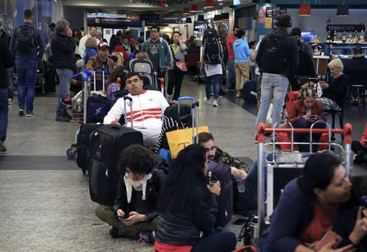Passengers await news at Aeroparque Jorge Newbery.