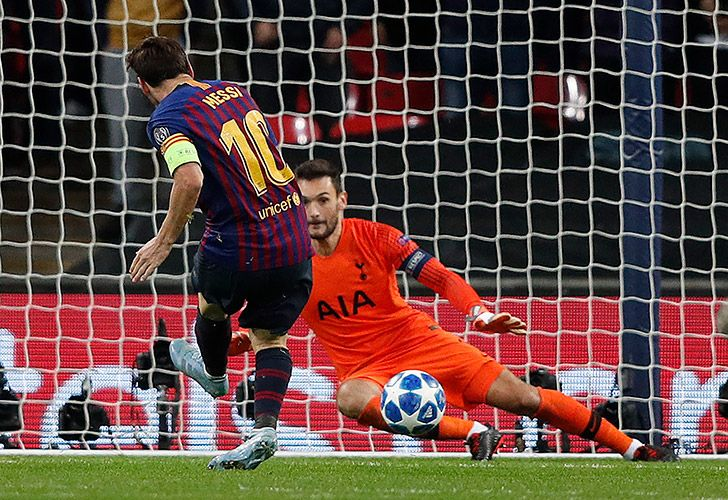 Barcelona forward Lionel Messi scores his team's fourth, and his second, goal past Tottenham Hotspur's French goalkeeper Hugo Lloris during the Champions League Group B football match at Wembley Stadium in London, on October 3, 2018.