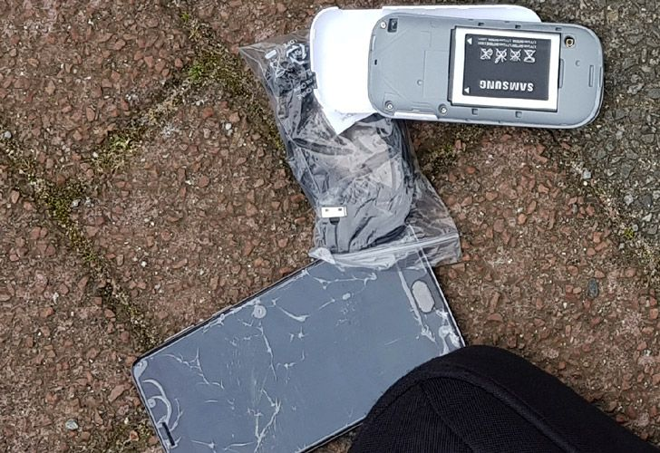 In this image released by the Dutch Defence Ministry on October 4, one of the many phones belonging to four Russian officers of the Main Directorate of the General Staff of the Armed Forces of the Russian Federation, GRU, is seen after one of the four officers tried to destroy it when they were caught on April 13, 2018.