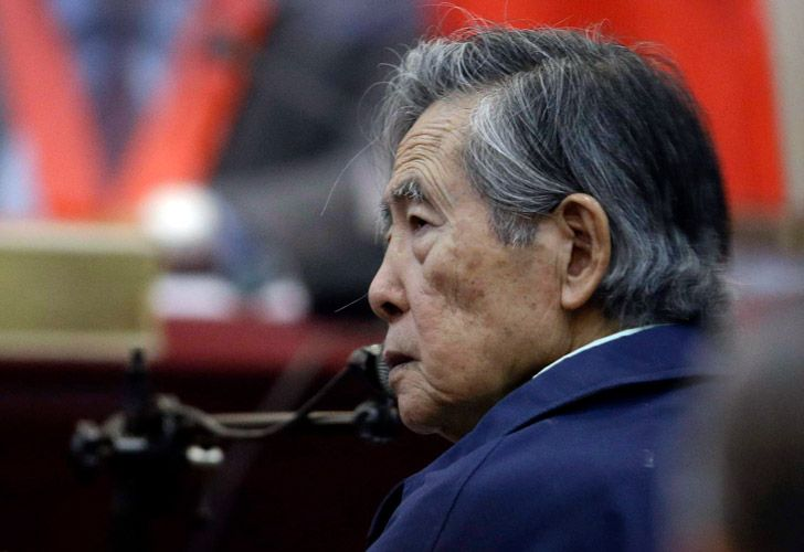 Peru's former President Alberto Fujimori listens to a question during his testimony in a courtroom at a military base in Callao, Peru.