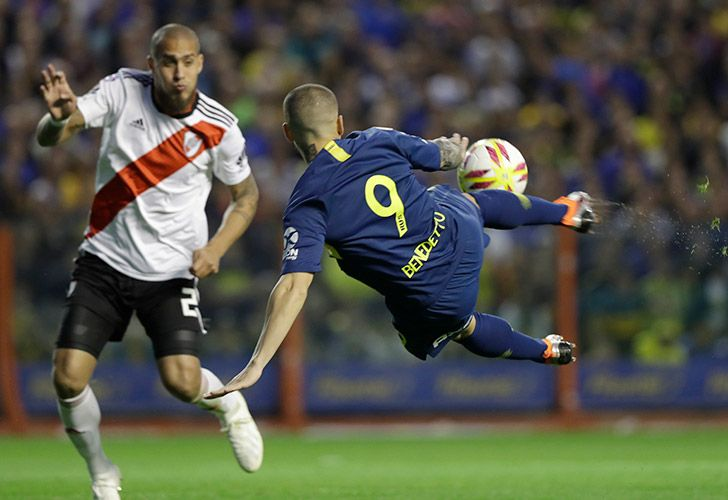 Dario Benedetto of Boca Juniors, right, strikes the ball as defender Jonatan Maidana of River Plate attempts to block him during the Superclásico clash back in September.