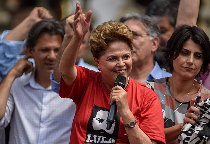 In this file photo taken on September 21, 2018, former Brazilian President and candidate for the Senate of Minas Gerais of Brazil's Workers' Party (PT), Dilma Rousseff (center), speaking to supporters during a campaign rally.