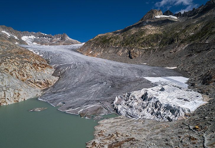 The Rhone Glacier and its glacial lake, near Gletsch, Switzerland. Avoiding global climate chaos will require a major transformation of society and the world economy that is