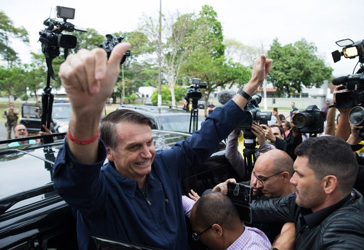 Brazil's right-wing presidential candidate for the Social Liberal Party (PSL) Jair Bolsonaro gives his thumbs up after casting his vote at Villa Militar, during general elections, in Rio de Janeiro, Brazil, on October 7, 2018.