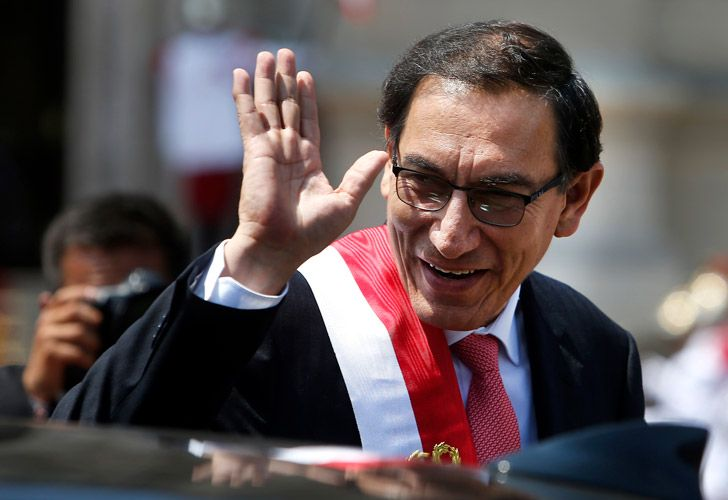 Peru's newly-sworn in President Martin Vizcarra waves as he makes his way to the Government Palace, in Lima, Peru.
