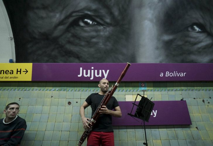 Venezuelan César Pérez, a member of the Latin Vox Machine orchestra, plays the basson at a Subte stop.