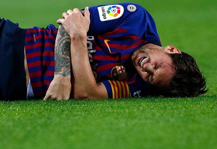 FC Barcelona's Lionel Messi is injured during the Spanish La Liga match between FC Barcelona and Sevilla at the Camp Nou stadium, Saturday, October 20, 2018.