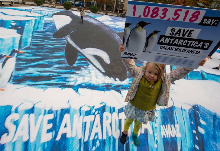A girl holds up a placard highlighting a petition from AVAAZ with one million signatures calling for a new marine reserve in the Antarctic.