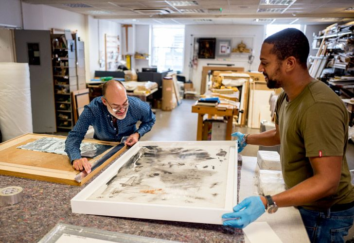 Government Art Collection staff members aclimatise paintings before they are shipped to British embassy buildings in tropical climates at Government Art Collection in central London