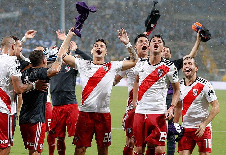 River Plate's players celebrate after defeating Brazil's Grêmio during the semi-final second leg match of the Copa Libertadores in Porto Alegre, Brazil last night.