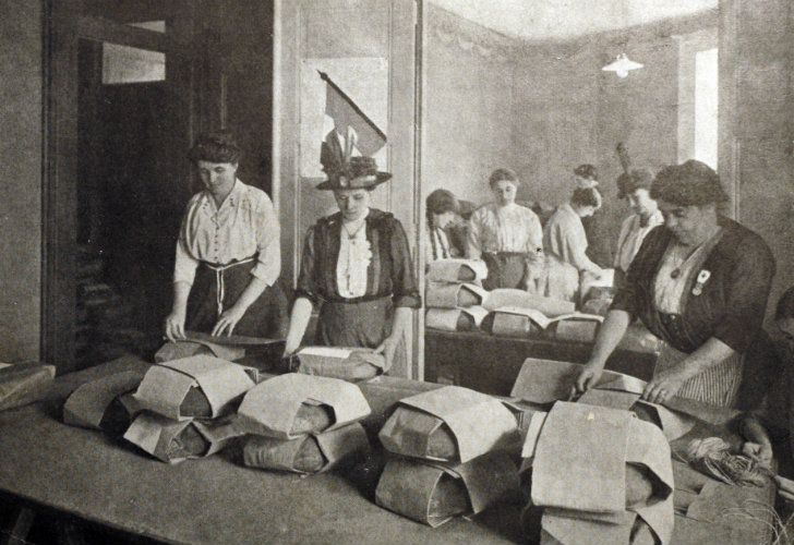 A postcard from 1916 shows women packing loaves of bread for troops on the front during World War I.