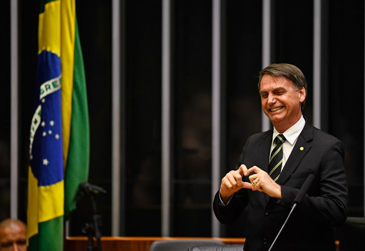 President-elect Jair Bolsonaro waves inside the Congress in Brasilia ahead of a ceremony celebrating the 30th anniversary of the Brazilian Constitution.